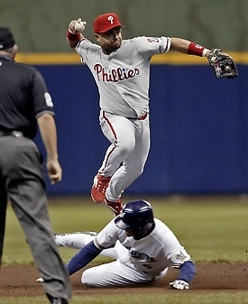 PLACIDO POLANCO - only Phillies to win Gold Gloves at two different positions - second base and third base.  Defense has been a problem for the current Phillies.